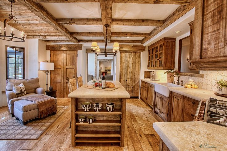 Kitchen Cabinetry for custom home in Truckee, Ca. Solid sugar pine, full mortise joinery and an aged wax finish. Accents of raw barn wood add texture at the island and refrigerator door panel.
