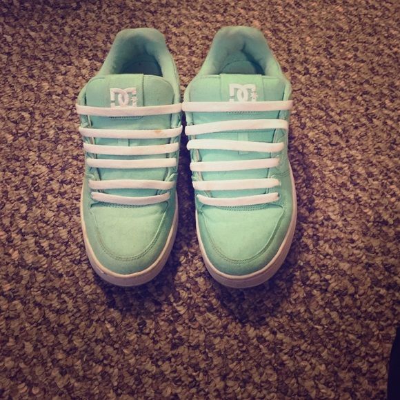 DC sneakers Greenish/teal dc sneakers. Pretty much new. There's a little stain on the shoelace but other than that the shoes are mint! Only worn a couple times DC Shoes Sneakers