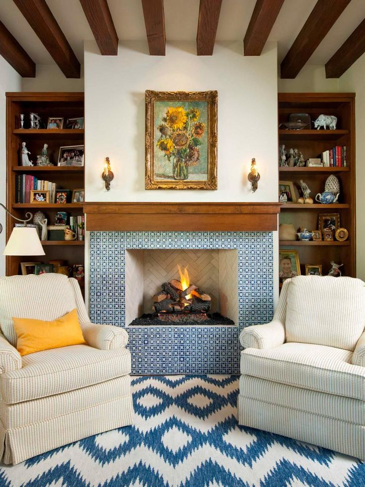 This+tiny+room+by+Astleford+Interiors+is+big+on+style,+thanks+to+the+fireplace's+Mexican+tile+surround.+Note+that+with+a+fireplace+this+fabulous,+it's+best+to+keep+the+mantel+simple+and+knick-knack+free.