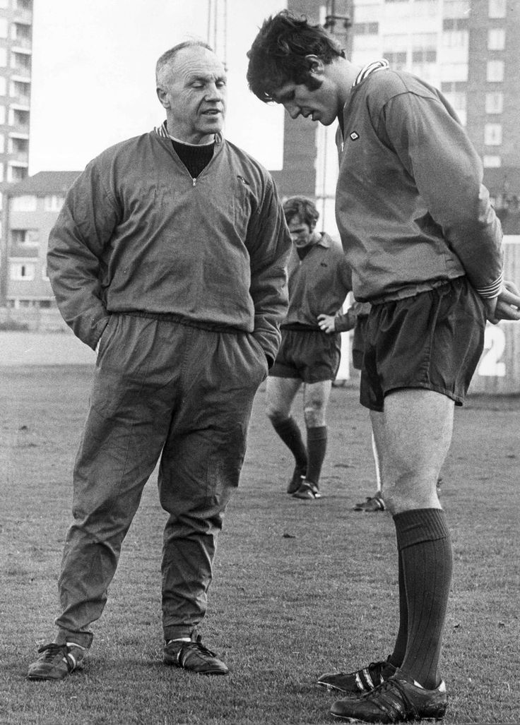 "Manager William ""Bill"" Shankly (Liverpool FC, 1959–1974) with forward John Toshack (Liverpool FC, 1970–1978, 246 apps, 96 goals)."