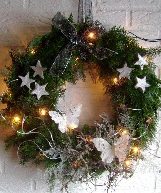Hmmm...could see this as an inspiring wreath... Gesso, flowers, stars glitter ribbons lace and lights