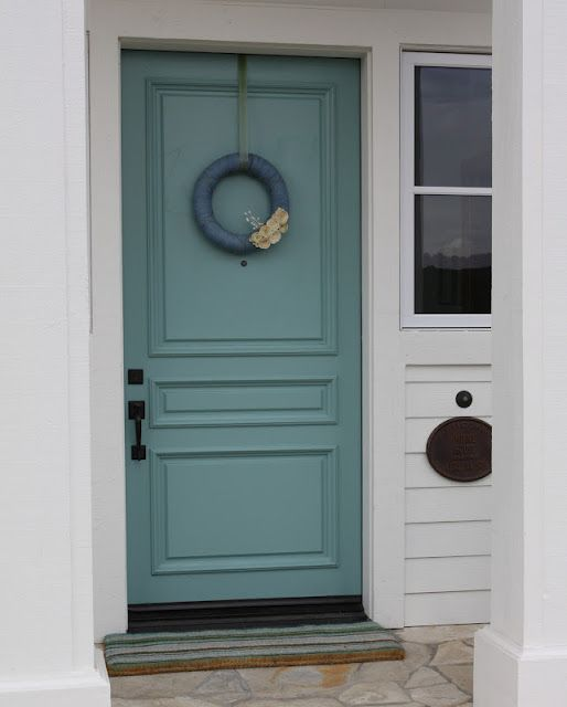 Door painted in Sherwin Williams Drizzle.  Gorgeous color!