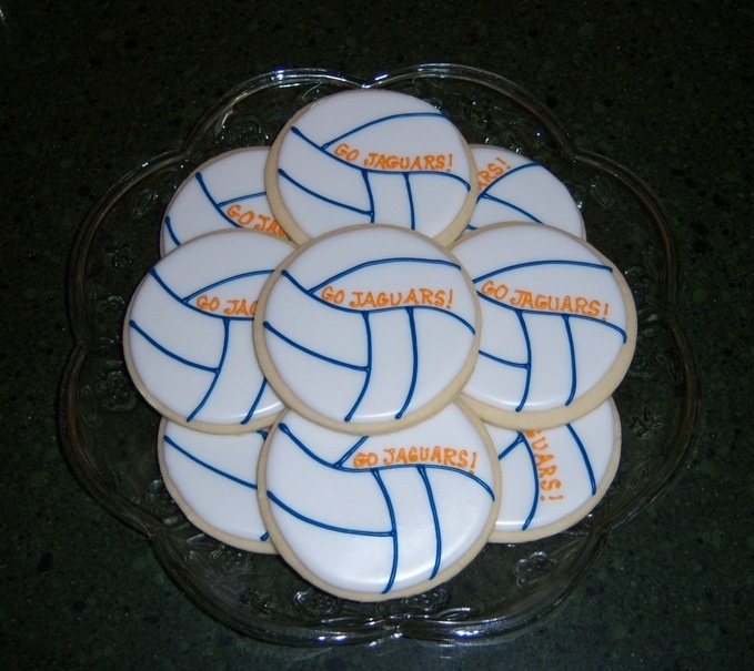 Volleyball - For the girls' volleyball team that my daughter coaches.  Scratch sugar cookies with glace.