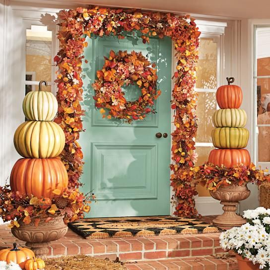 Stacked Pumpkins Fall Porch Idea. See more Fall Porch Decorating Ideas on www.prettymyparty.com.