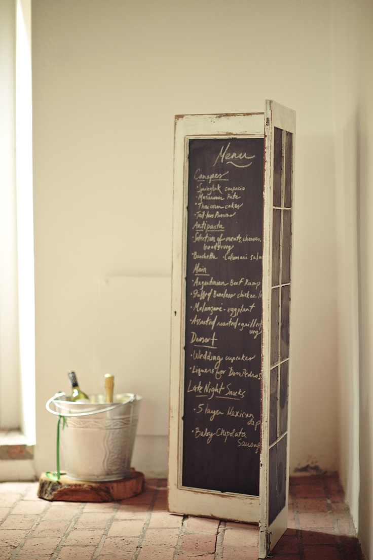 metal pails we picked up at a local craft market which doubled as beer buckets/wine coolers for serve yourself style refreshments. And a cool old hinged window/door frame which had the panes replaced with chalk board, used to display the menu and seating plan. The door was rented from www.quirkyparties.co.za