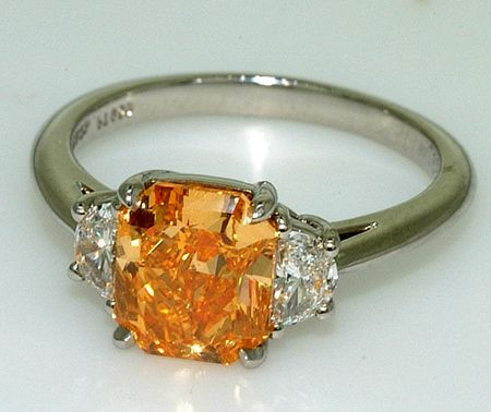 """Orange Diamond Ring ..When thinking about diamonds most people don't think of a rainbow of color, with every hue or shade possible, but actually diamonds come naturally in over three hundred possible colors. They range from """"pumpkin"""" orange, to pale pink and """"canary"""" yellow. In fact, some of the world's most well-known and largest stones are not clear, glass-like examples of a diamond, but enormous colored gems."""