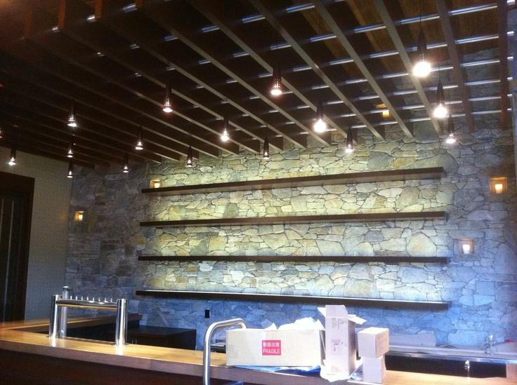 Bar shelves are lit with LED tape light. Brings the light ...