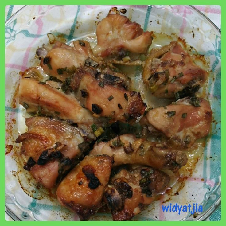 Oven baked chicken tight with garlic, lemon and scallion