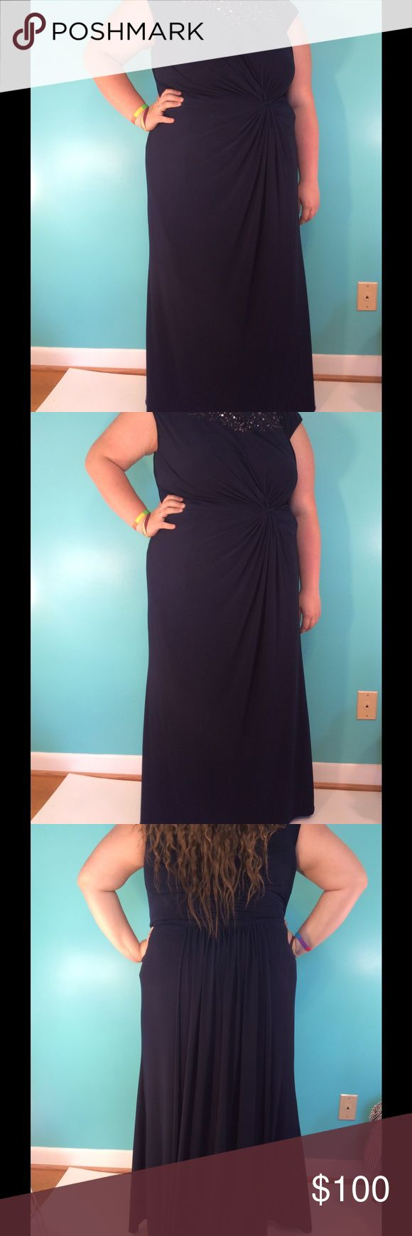 CLEARANCE Prom dress This navy blue dress is great for prom, weddings, and other formal occasions. It has jewels on the top along the neck line. There is also a train in the back that is the length of the dress Ignite Evenings Dresses Prom