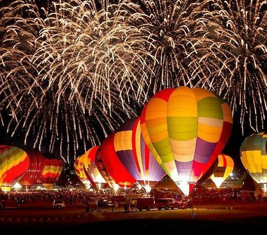 Balloon fiesta Albuquerque, NM! You need to go to the night glow and go to the early morning lift offs!