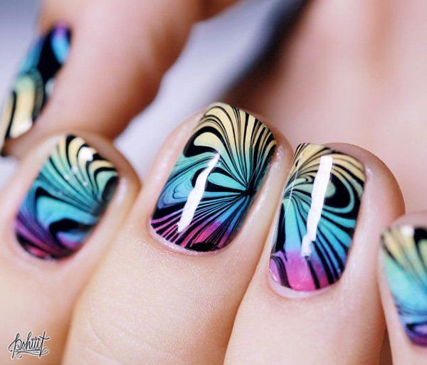 Make your gradient nails perfect by adding water marble nail art designs using black polish and creating flower patterns.