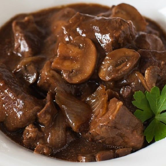 Beef stew with mushrooms. Cubed beef with mushrooms and onion soup cooked in slow cooker. Very easy and delicious recipe.