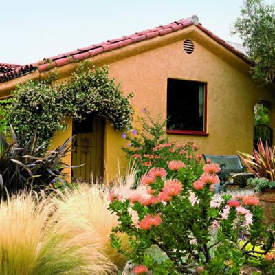 Lush garden, light touch  Instead of expanding their 1,250-square-foot Spanish colonial revival home ― even though there was ample room on the lot to do so ― Gabe Gelbart and landscape designer Paul Rhoadzhagen