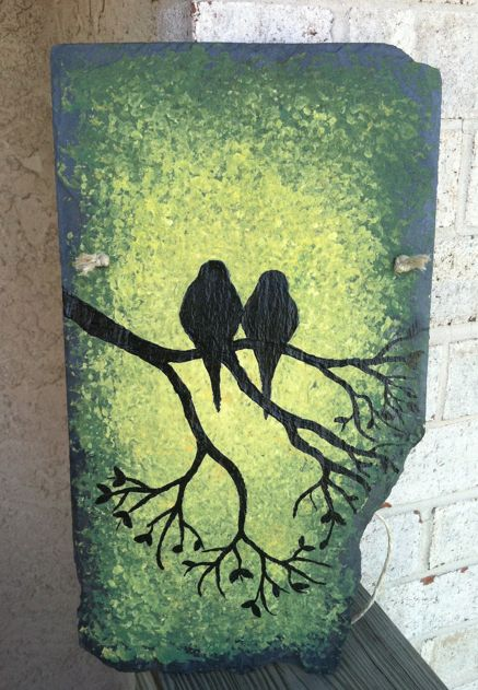 The background is 7 different colors painted with sea sponge on old slate...