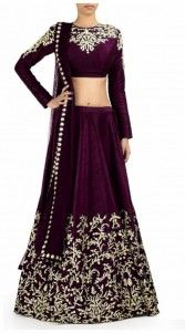 Pretty purple shantoon, raw silk and net designer crop top lehenga which is decked with a resham embroidery work on the skirt part. This attire comes with matching dupatta. This unstitched choli can be stitched in the maximum bust size of 54 inches...