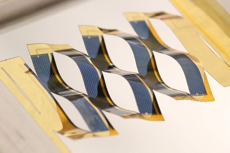 By borrowing from kirigami, the ancient Japanese art of paper cutting, researchers at the University of Michigan have developed solar cells that can track the sun. A flat plastic sheet backing the solar cells splits into wavy, connected ribbons when stretched. The tilt of the cells depends on the stretching, a simple mechanism for tracking the sun across the sky. Image credit: Aaron Lamoureux