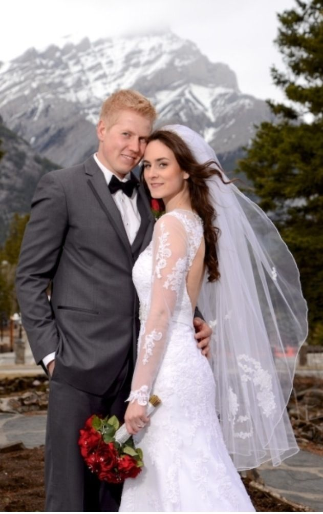 Banff Alberta wedding. Long sleeve wedding dress. Grey tux. Bow tie. Veil. Red rose bouquet.