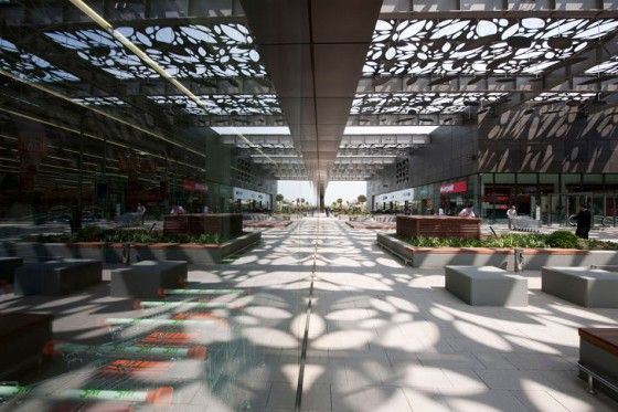 Asmacati shopping center in Aegaen city, Turkey.  Natural light and ventilation thanks to the designs of the cover.