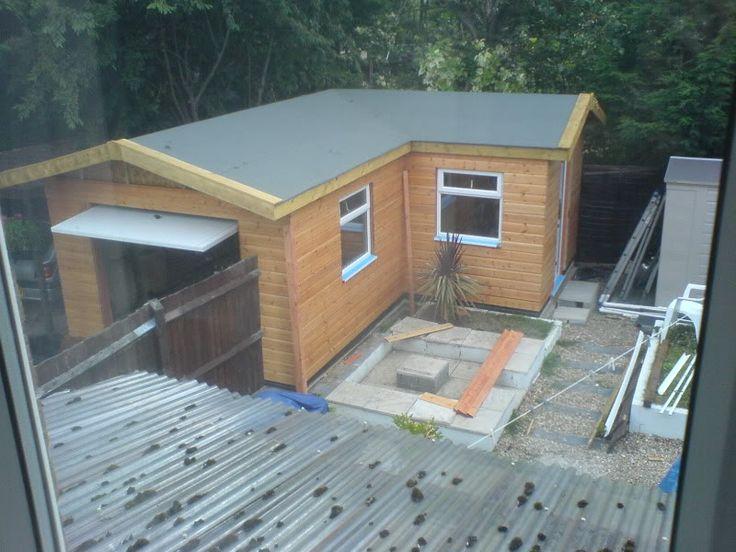 Detached L Shaped Garage.