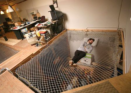 Hammock Net Bed. An interesting solution for a loft home, maximizes airflow between the floors.