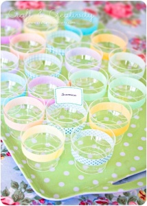 Decorate clear plastic cups with washi tape. Decorate in the color and theme of your party