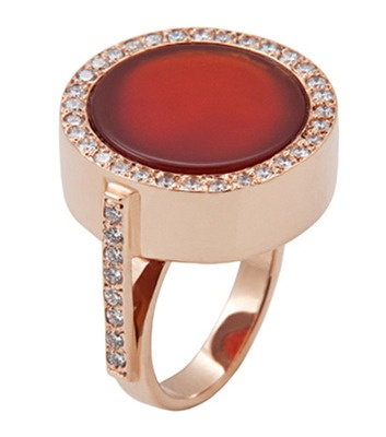 Carnelian.  I love the flat round stone - not the setting.  Plain gold ancient design better.