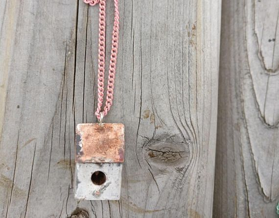 "Mixed Metal Birdhouse. This hand-fabricated necklace is 1"" tall. It is made out of copper and silver, on an enamel-coated 32"" brass chain. The birdhouse is lightly heat treated for a weathered look."