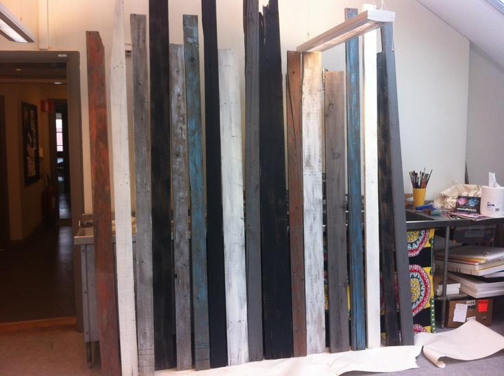 Painting the floorboards in the studio