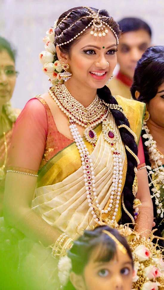 0f5a25bdbc 15 Kerala Wedding Sarees & Blouse Designs | kerala saree bridal ...