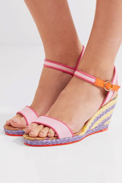 Sophia Webster's 'Lucita' sandals combine a rich variety of fabrics to playful effect. The baby-pink canvas straps are trimmed with bright-pink and neon-orange leather and are set upon a pastel-yellow and purple espadrille wedge. The flecked cork footbed completes the whimsical picture.