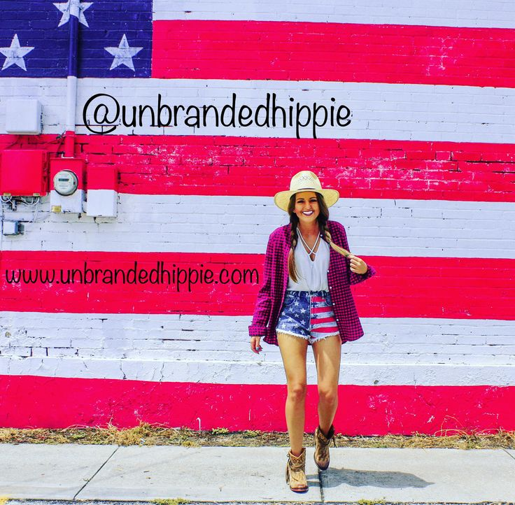 American flag shorts paired with a flannel shirt make the perfect 4th of July outfit! Throw on a rodeo king hat for a hippie western flare!