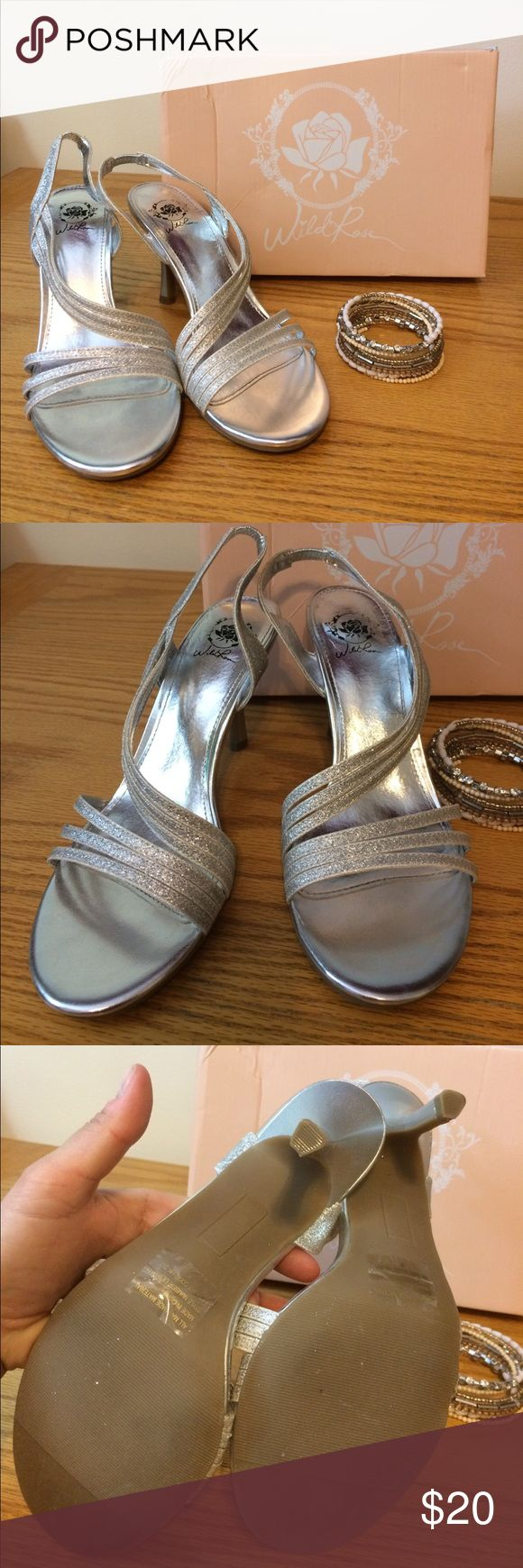 NWOT silver dress heels NEVER WORN!!! These were purchased for a wedding and then I never wore them. Silver sparkly dress heels.  So pretty! Wild Rose Shoes Heels