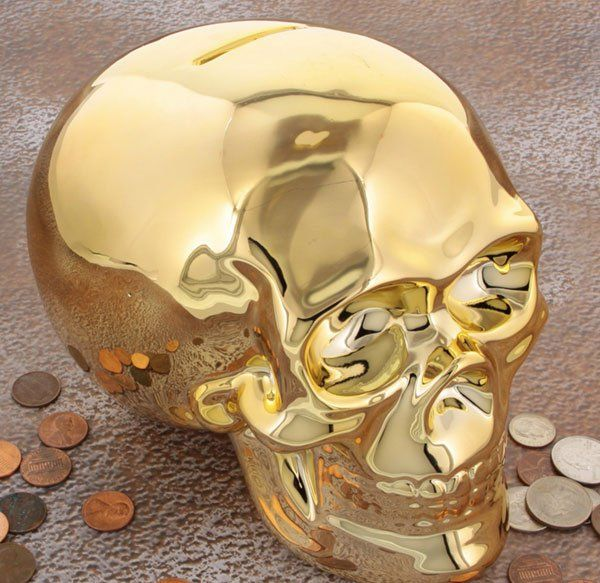 Gold Skull Coin Bank by Retro Planet. A ceramic piggy bank ready to hold your hidden treasure! This golden skeleton bank features a 3D skull design with a shiny gold color. Great for a pirate-theme kid's bedroom! http://zocko.it/LEX5K