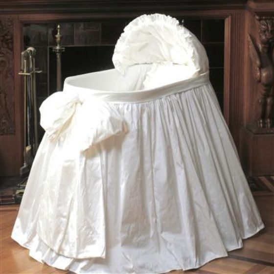 Simple bassinet skirt ... Would be sweet with a bow on each end, no hood (it got lost)