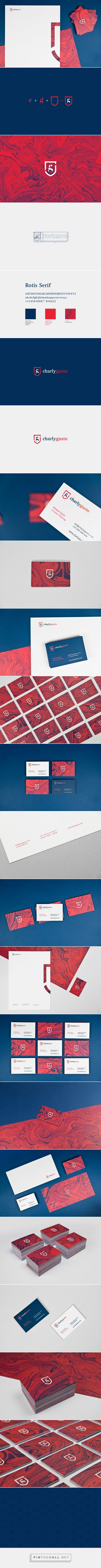 """Charly Gusto has used a crest with fusion of lowercase serif """"g"""" and """"c"""" as a logo. He has followed a colour scheme of red white and blue as a brand identity. The logo has been applied on business cards, web and the side of the crest has been used for a letter. The simple design makes it recognisable across the mediums, which is why I think cutting off most of the logo works on the letter paper."""