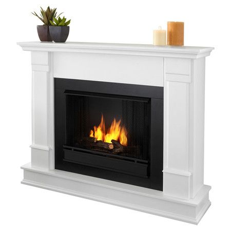 Keep toasty on family game night or during your next dinner party with this free-standing electric fireplace, showcasing crown moldings and stainless steel h...