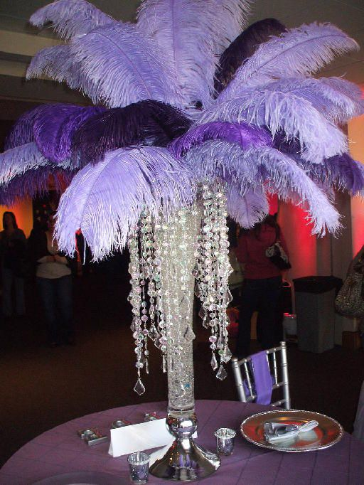 Centrepiece by Pure Dymonds Events. Lavender and Dark Purple feathers with bling