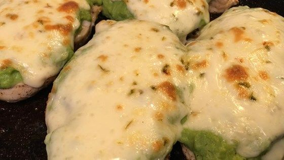 Seasoned chicken breasts are browned in butter and olive oil, topped with homemade guacamole and slices of pepper jack cheese, then broiled.