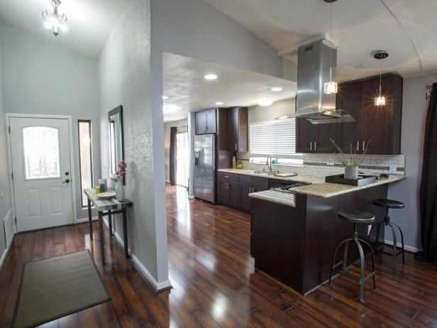 Neutral Kitchen With Rustic Wood Laminate Floor and Dark Wood Cabinets