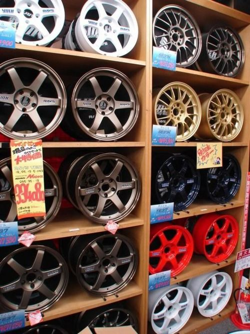 Rays - Volk Racing.  If I'm ever rich this will be my shoe closet for my cars ;)