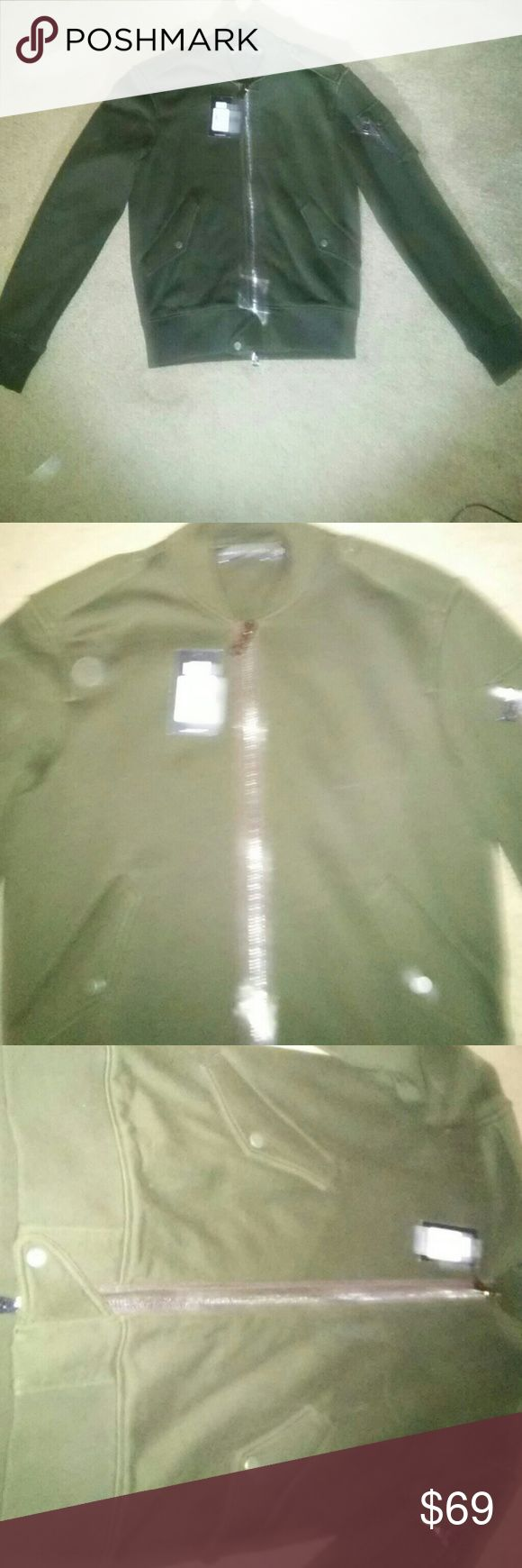 Ralph Lauren Zip Up Jacket Size S This zip up dark green jacket is from the top of the line Ralph Lauren line of Polo Clothing. It retails for $595 and was on sale for $476.  Its model.# 080 438427 Alpine. Its never been worn just tried on and the tag was removed but when you see it it very obvious its never been worn. Its a extremely sharp looking jacket with a sort of sweat shirt feel to it. It has decent weight to it so it will keep you worm but not too worm. Ralph Lauren Jackets & Coats…