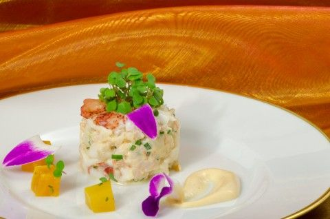 Small lobster charlotte with diced cucumbers, Bourbon vanilla emulsion. Cold appetizer.