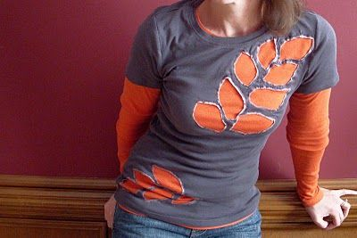 draw pattern with bleach pen on tshirt, cut out pattern, layer over another tshirt...simple