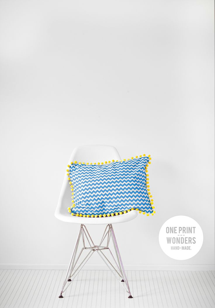 Lil Chevs in blue with yellow pom-pom trim. © One Print Wonders