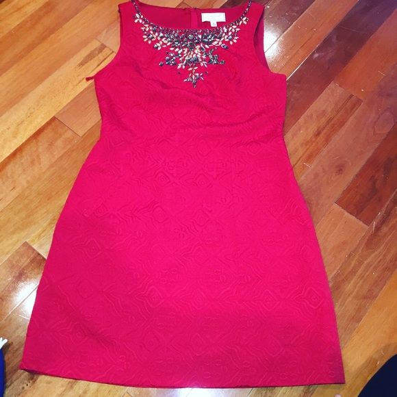 Formal (sorority) dress A formal red dress with jewels/gems in a design at the chest. Perfect for anything from business dinner- sorority happenings. Dresses