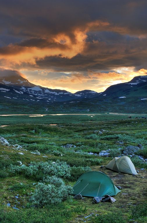 Camping in the arctic along the Kungsleden at Singistugorna below Rusjka (1708m) and Unna Ruskkas (1477m).  The Kungsleden or King's Trail is a hiking trail in the far north of Sweden that is approximately 440-kilometre (270 mi) long, between Abisko in the north and Hemavan in the south. It passes through one of Europe's largest remaining wilderness areas. Lapland, Sweden