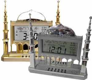 Auto Islamic Azan Clock with Qibla Direction (QAC-850) - Transparent Table Top Masjid Design. Digital Adhan clock with 1000 Cities Adhan Times and Qibla Direction Finder. Specify the city and current time and it calculates all the prayer times automatically and displays each one on the screen. You can also adjust the Azan time +/- 30 min if needed. It plays one of the selected Azans automatically when it is prayer time. It makes a perfect gift for all Muslims.  muslimzon.com