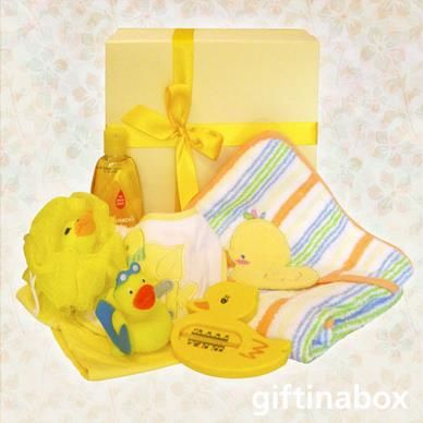 """Quack, quack, here comes Daffy Duck! A lovely assortment of duck themed baby products for the new little """"ducky"""" in their lives.   Duck themed hooded towel Duck bath thermometer Plastic bath duck Duck mesh sponge Duck themed bib Yellow full baby grow Johnsons baby shampoo"""