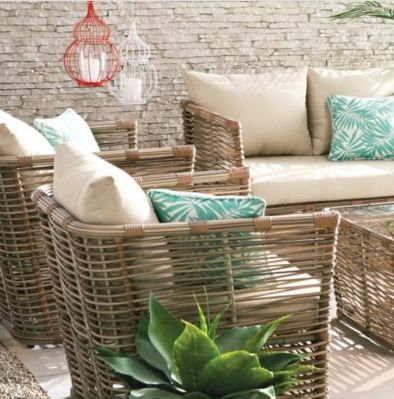 Create a tropical backyard or patio with simple, modern wicker chairs.