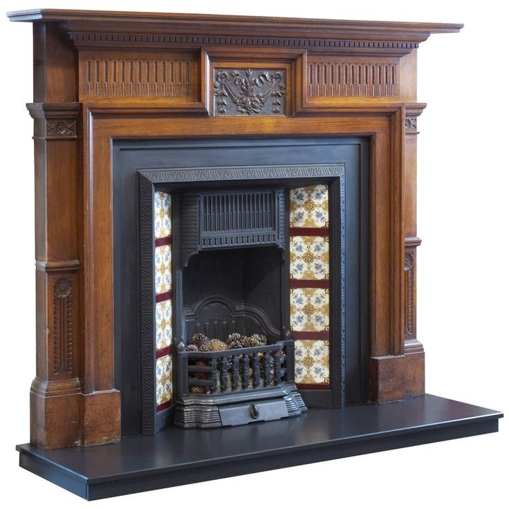 Irish Early 20th Century Edwardian Hand-Carved Walnut Fireplace Surround | From a unique collection of antique and modern fireplace tools and chimney pots at https://www.1stdibs.com/furniture/building-garden/fireplace-tools-chimney-pots/